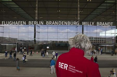 People take a tour of the site of the new Berlin Brandenburg airport outside Berlin, May 12, 2012. REUTERS/Thomas Peter