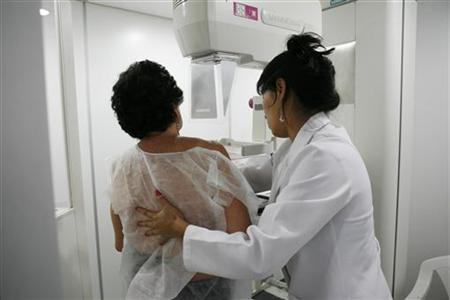 A woman undergoes a free mammogram inside Peru's first mobile unit for breast cancer detection, in Lima March 8, 2012. REUTERS/Enrique Castro-Mendivil