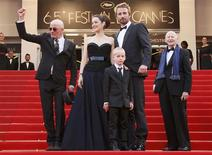 "Director Audiard (L) arrives on the red carpet with cast members Matthias Schoenaerts (2ndR), Armand Verdure (C) and Marion Cotillard for the screening of the film ""De rouille et d'os"", in competition at the 65th Cannes Film Festival, May 17, 2012. REUTERS/Yves Herman"