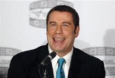 "Actor John Travolta speaks during a news conference to promote the film ""Gotti : Three Generations"" in New York April 12, 2011. REUTERS/Brendan McDermid"