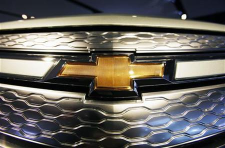 A Chevrolet logo is seen on the front of a Volt electric vehicle during the press days for the North American International Auto show in Detroit, Michigan, January 11, 2011. REUTERS/Mark Blinch
