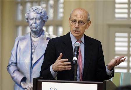Supreme Court Associate Justice Stephen Breyer speaks alongside a life-size cutout of Eleanor Roosevelt, at the American Society of International Law's 106th meeting in Washington, March 29, 2012. REUTERS/Jason Reed