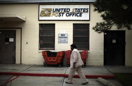 Betty Terry walks past a post office which closed its counter services four years ago at the Veterans Administration in Los Angeles, California January 30, 2012. REUTERS/Lucy Nicholson