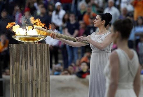 Lighting the Olympic torch
