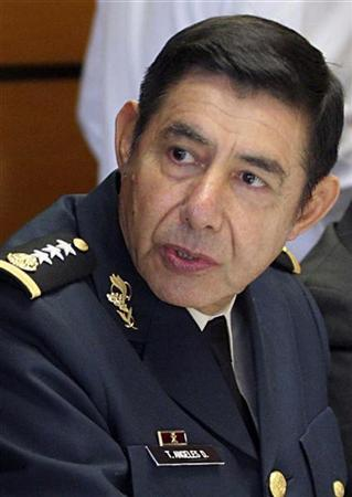 Former General Tomas Angeles Dauahare listen as he takes part in a working meeting at Mexico's congress in Mexico City January 22, 2008. REUTERS/Stringer