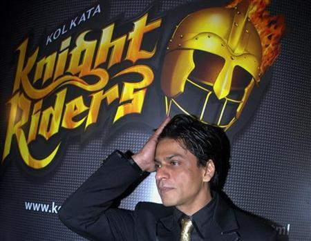Shah Rukh Khan poses for photographers during a news conference in Mumbai March 13, 2008. REUTERS/Manav Manglani/Files