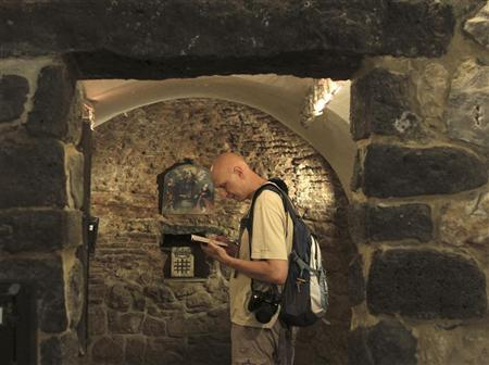 A tourist visits the St. Ananias church, dating back to the first century, in Damascus June 3, 2010 in this file photo. REUTERS/Khaled al-Hariri
