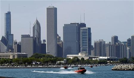 Chicago's skyline is seen as U.S. Coast Guard boats leave Burnham harbor on Lake Michigan, near McCormick Place, in the days leading up to the NATO Summit in Chicago May 17, 2012. The summit runs from May 20 to 21. REUTERS/Frank Polich