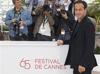 "Director Matteo Garrone poses during a photocall for the film ""Reality"", in competition at the 65th Cannes Film Festival, May 18, 2012. REUTERS/Vincent Kessler"