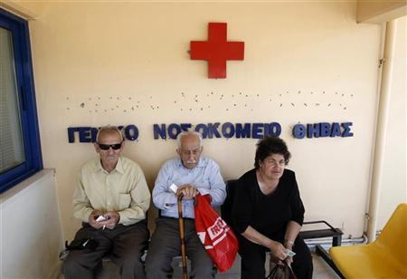 Local residents sit outside of the town's hospital in the town of Thebes, about 88 km (55 miles) northwest of Athens, June 20, 2011. REUTERS/John Kolesidis
