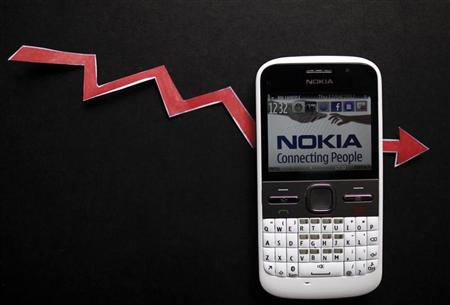 File photo of a Nokia smartphone with currency graph on display is seen in Zenica. REUTERS/Dado Ruvic/Files