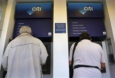 Two men withdraw money from an ATM in central Athens May 16, 2012. REUTERS/Yannis Behrakis