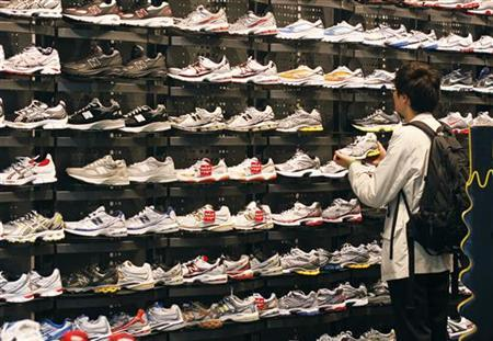A man shops for shoes at a Foot Locker store in New York October 14, 2010. REUTERS/Shannon Stapleton