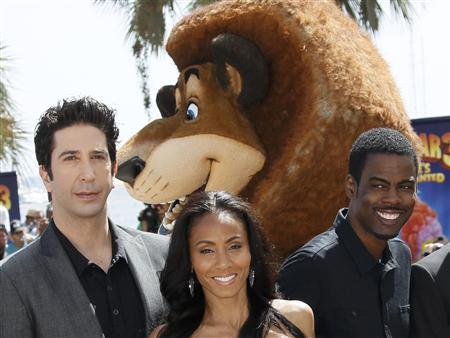 Voice actors David Schwimmer (L), Jada Pinkett-Smith (C) and Chris Rock (R) pose during a photocall for the animated film ''Madagascar 3:Europe's most wanted'' at the 65th Cannes Film Festival May 17, 2012. Picture taken May 17, 2012. REUTERS/Yves Herman