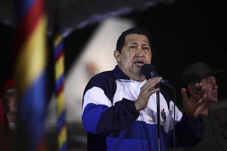 Venezuelan President Hugo Chavez speaks after arriving from Cuba, at Simon Bolivar airport in Caracas May 11, 2012. REUTERS/Miraflores Palace/Handout