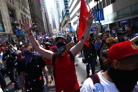 Protesters march during a demonstration leading up to the NATO Summit in Chicago May 18, 2012. The Summit runs from May 20-21. REUTERS/Eric Thayer