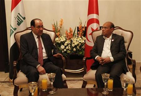 Iraqi Prime Minister Nuri al-Maliki (L) meets with Tunisia's President Moncef Marzouki in Baghdad March 29,2012. REUTERS/Iraqi Prime Minister Media Office/Handout
