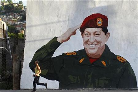 A man walks past a mural depicting Venezuelan President Hugo Chavez in Caracas May 15, 2012. REUTERS/Jorge Silva