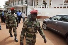 Guinea Bissau's soldiers leave a news conference at the military headquarters in the capital Bissau, March 19, 2012. REUTERS/Joe Penney