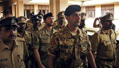 Salvatore Girone (C) and Latorre Massimiliano (3rd R), members of the navy security team of Napoli registered Italian merchant vessel Enrica Lexie, are escorted as they leave a courtroom at Kollam in Kerala March 5, 2012. REUTERS/Sivaram V/Files
