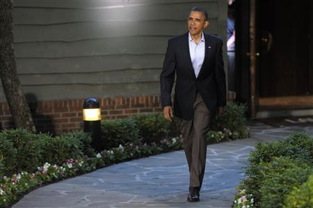 President Barack Obama walks to welcome guests at the G8 summit in Camp David, May 18, 2012. REUTERS/Philippe Wojazer