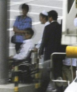 China's blind activist Chen Guangcheng (in wheelchair) heads for his flight bound for New York at Beijing's international airport in this photo taken by Kyodo May 19, 2012. REUTERS/Kyodo