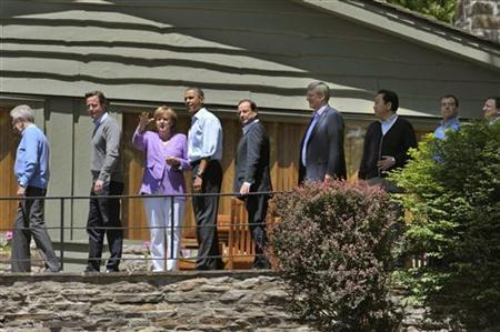 Leaders walk to the family photo session at the G8 summit at Camp David, Maryland May 19, 2012. From L-R: Italy's Premier Mario Monti, Britain's Prime Minister David Cameron, German Chancellor Angela Merkel, U.S. President Barack Obama, France's President Francois Hollande, Canada's Prime Minister Stephen Harper, Japan's Prime Minister Yoshihiko Noda, Russia's Prime Minister Dmitri Medvedev and European Commission President Jose Manuel Barroso. REUTERS/Philippe Wojazer