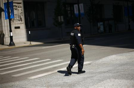 A police officer patrols a street before the NATO Summit in Chicago May 19, 2012. Leaders from members of the NATO alliance are expected to discuss the worsening situation in Afghanistan, and protest organizers said they hope thousands of people will turn out to demonstrate against the war and other issues such as income inequality. The Summit runs from May 20-21. REUTERS/Eric Thayer