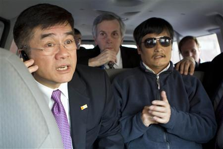 U.S. Ambassador to China Gary Locke (L) talks on a mobile phone as he accompanies blind activist Chen Guangcheng (R) in a car, in Beijing, in this May 2, 2012 file photo. China has allowed blind legal activist Chen Guangcheng to leave a hospital in Beijing for the United States, a U.S.-based Christian advocacy group said on May 19, 2012. REUTERS/US Embassy Beijing Press Office/Handout/Files