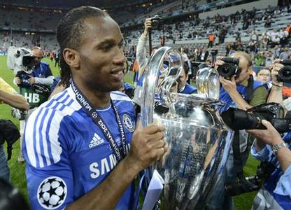 Didier Drogba of Chelsea holds the UEFA Champions League trophy after his team's final soccer match against Bayern Munich at the Allianz Arena in Munich, May 19, 2012. REUTERS/Dylan Martinez