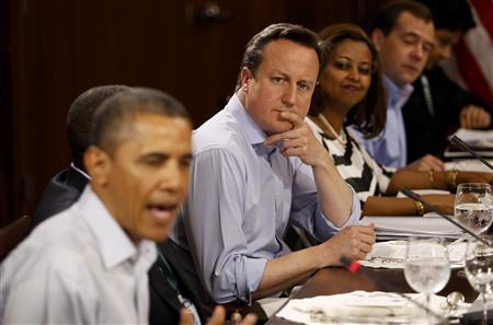 Britain's Prime Minister David Cameron listens as U.S. President Barack Obama (L) speaks during an expanded G8 working luncheon with leaders from African countries and others at the G8 Summit at Camp David, Maryland, May 19, 2012. REUTERS/Andrew Winning