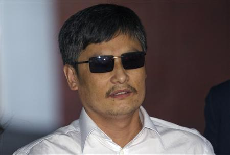 Blind Chinese dissident Chen Guangcheng speaks to members of the media after arriving in New York May 19, 2012. REUTERS/Keith Bedford