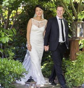 Facebook co-founder and CEO Mark Zuckerberg and Priscilla Chan are seen in this wedding photo May 19, 2012. Zuckerberg wed longtime girlfriend Chan on Saturday, announcing the nuptials through a status update on the social networking site. REUTERS/Allyson Magda/Facebook.com/Handout