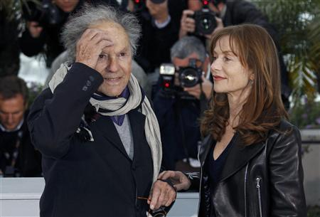 Cast members Isabelle Huppert (R) and Jean-Louis Trintignant pose during a photocall for the film ''Amour'', by director Michael Haneke, in competition at the 65th Cannes Film Festival, May 20, 2012. REUTERS/Vincent Kessler