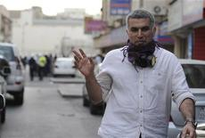 Bahrian's Human Rights Activits, Nabeel Rajab, gives a victory sign during an anti-government protest held in downtown Manama February 11, 2012. REUTERS/Stringer