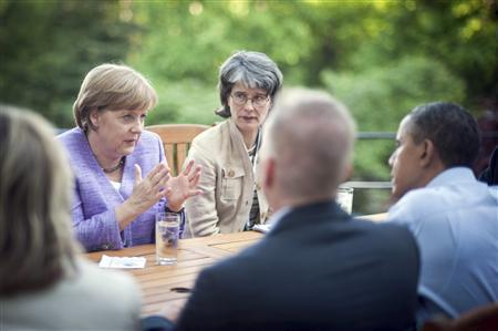 U.S. President Barack Obama (R) listens to German Chancellor Angela Merkel following the G8 summit in Camp David, May 19, 2012. REUTERS/Bundesregierung/Guido Bergmann/Pool