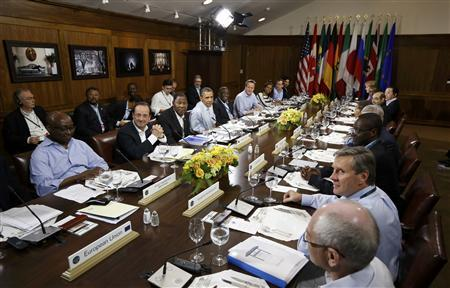 U.S. President Barack Obama (6thR) hosts an expanded G8 meeting with African and other leaders at the start of a working lunch during the G8 Summit at Camp David, Maryland, May 19, 2012. REUTERS/Jason Reed
