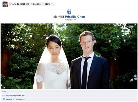 Facebook co-founder and CEO Mark Zuckerberg and Priscilla Chan are seen in this screengrab of a wedding photo posted on Zuckerberg's Facebook page May 19, 2012. REUTERS
