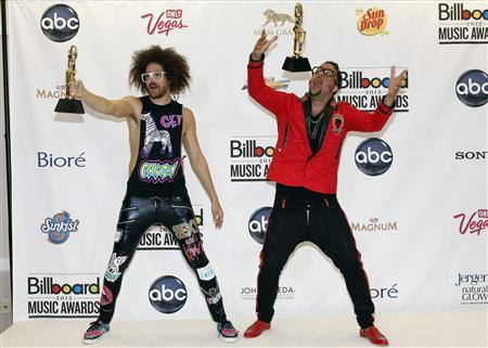 Redfoo (L) and SkyBlu of LMFAO pose with their awards backstage during the Billboard Music Awards at MGM Grand Garden Arena in Las Vegas May 20, 2012. REUTERS/Steve Marcus