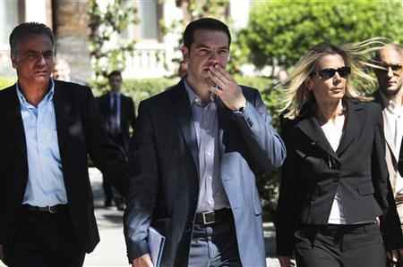 Head of Greece's Left Coalition party Alexis Tsipras (C), accompanied by party officials, leaves from the Presidential palace following a meeting with political leaders and the Greek President in Athens May 15, 2012. REUTERS/Yorgos Karahalis