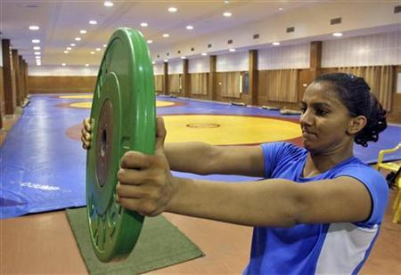 Wrestler Geeta Phogat lifts a weight as she exercises during a practice session inside the Netaji Subhas National Institute of Sports in Patiala in Punjab May 5, 2012. REUTERS/Ajay Verma