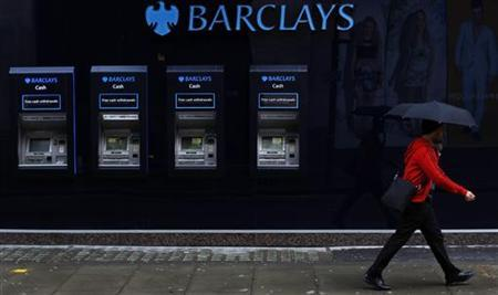 A man walks past a branch of Barclays bank in central London April 26, 2012. REUTERS/Andrew Winning