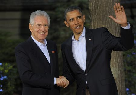 Italian Prime Minister Mario Monti is welcomed by U.S. President Barack Obama at the G8 summit in Camp David, May 18, 2012. REUTERS/Philippe Wojazer