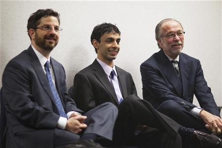 Dharun Ravi (C), a former Rutgers University student charged with bias intimidation, sits with defense attorneys Steven Altman (R) and Philip Nettl while awaiting a verdict in his trial at the Superior Court of New Jersey in Middlesex County, New Brunswick, New Jersey March 16, 2012. REUTERS/Lucas Jackson