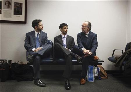 Dharun Ravi (C), a former Rutgers University student charged with bias intimidation, sits with defense attorneys Steven Altman (R) and Philip Nettl while awaiting a verdict in his trial at the Superior Court of New Jersey in Middlesex County, New Brunswick, New Jersey March 16, 2012. REUTERS/Lucas Jackson/Files