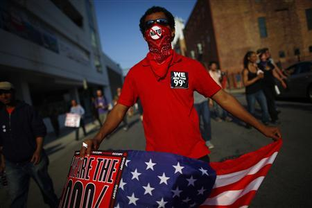A demonstrator marches during a protest on the eve of a NATO summit in Chicago May 19, 2012. A two-day NATO summit which starts May 20 will draw representatives from some 50 countries, including leaders of the 28 members of the military alliance. REUTERS-Eric Thayer