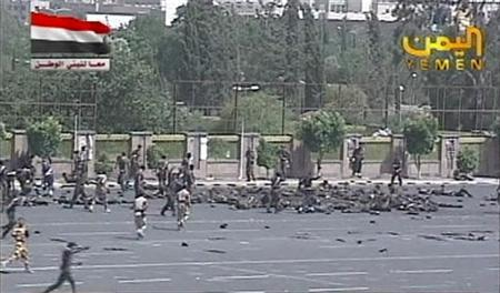 A still image taken from video shows army personnel running to the scene of a suicide attack in Sanaa May 21, 2012. A uniformed man blew himself up in the midst of a military parade rehearsal attended by senior officials in the Yemeni capital Sanaa on Monday, killing 63 soldiers, a police source said. REUTERS-Yemen TV via Reuters TV