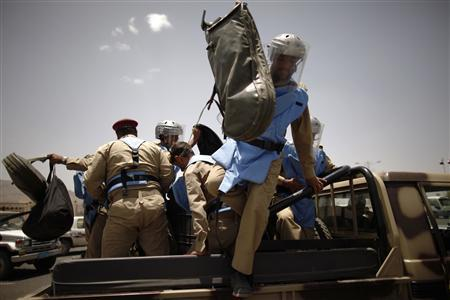 An explosives expert jumps from a military truck as he arrives at the site of a suicide bomb attack at a parade square in Sanaa May 21, 2012. REUTERS-Khaled Abdullah
