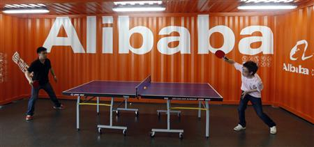 Employees play table tennis inside the headquarters office of Alibaba (China) Technology Co. Ltd on the outskirts of Hangzhou, Zhejiang province in this May 17, 2010 file photograph. Yahoo Inc shares rose as much as 6.7 percent on May 18, 2012 after a report that it was close to selling part of its valuable stake in the Alibaba Group. Yahoo and Alibaba Group, the Chinese Internet group that runs e-commerce site Alibaba.com, are close to an agreement that could happen as soon as Monday, according to a report in All Things D, citing unnamed sources. REUTERS/Steven Shi/Files