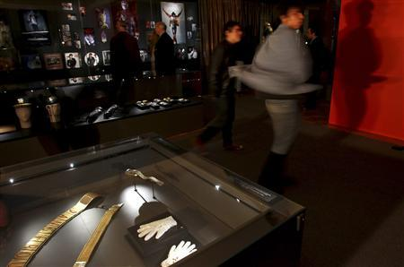 A Michael Jackson fan dances during an exhibition at the Fashion Museum in Santiago, May 18, 2012. Sunglasses, jackets, suits, shoes and different objects which were used by the ''King of pop'' are displayed during the ''Icon and Idols'' tour which will be seen in South America, Europe and Asia. REUTERS/Ivan Alvarado